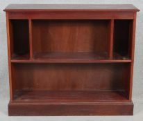 A contemporary mahogany open bookcase on plinth base. H.83 W.96.5 D.25cm