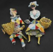 Two vintage ceramic hand painted harlequin figures, male and female with baskets. H.36cm