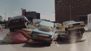 A signed coloured photo by Scottish artist David Mach of his sculpture Multi Story Car Park, May,