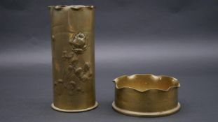 Two Trench Art brass planters. H.19.5cm