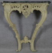 A 19th century carved and painted Rococo style console table with shaped and veined marble top. H.83