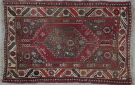 A Heriz rug with double pole central medallions in a stylised multi border. L.148 W.104cm