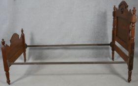 """A late 19th century American bedstead to take a single mattress. 40.5"""" wide"""