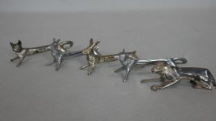 A set of five silver plated novelty knife rests in the shape of various animals. H.4.5 L.9cm