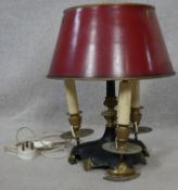 A vintage brass and metal three branch bouillotte lamp with toleware shade. H.40cm