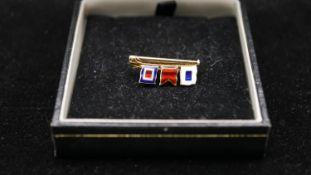 A 9ct signal flag sweetheart brooch, spells SBW, each flag enamelled. Hallmarked JWB, Birmingham,