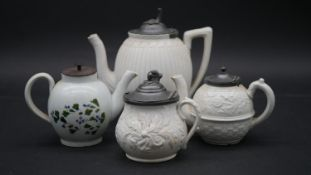 Three 19th century stoneware teapots with pewter lids and raised foliate decoration along with an