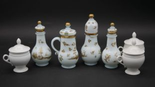 A Chinese style four piece condiment set with hand gilded decoration (chipped as photographed) along
