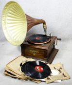 A C.1900 gramophone with a Columbia Graphophone Company patent plaque along with a selection of 78