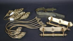 A pair of Victorian brass door handles along with various brass hooks and curtain fittings. 37cm