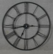 A contemporary metal framed clock face, battery operated with large Roman numerals. D.102cm