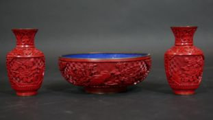 A Chinese carved cinnabar lacquer bowl with blue enamel interior and a pair of similar vases. Dia.