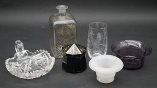 A 19th century blue glass and gilded lidded jar, a gilt decorated decanter, an etched glass and