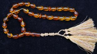 A string of thirty six baltic amber prayer beads, thirty two beads contain insect inclusions. Weight