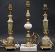 A pair of vintage onyx and brass table lamps and a similar single table lamp. H.37.5cm