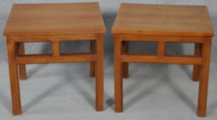A pair of Chinese influenced hardwood lamp tables on square section supports. H.45 L.48 W.47cm