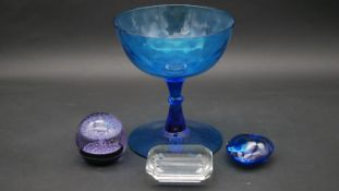 A Tiffany and Co glass paperweight, a Caithness paperweight numbered and marked Ice Fountain, a blue