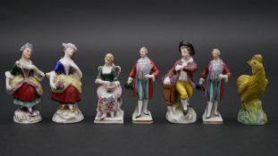 Seven hand painted porcelain miniature figures to include ladies and gentlemen and a rooster, some