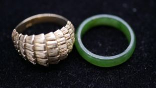 A 9 carat yellow gold textured abstract form dress ring, stamped 9ct along with a Chinese jade band.