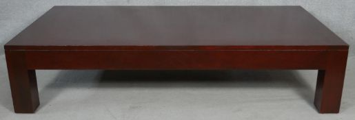 A large contemporary coffee table on block supports. H.41.5 L.182 W.92cm
