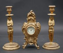 A pair of Classical style gilt metal candlesticks with caryatid stems and a French style gilt