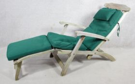 A contemporary weathered teak steamer deck chair by Indian Ocean with fitted cushion. H.100 W.52 L.