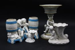 A 19th century Mintons tazza with a seated cherub support, A Royal Worcester cornucopia epergne vase