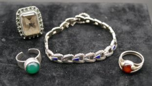 An Art Deco articulated silver and blue enamel bracelet set with marcasite along with three silver