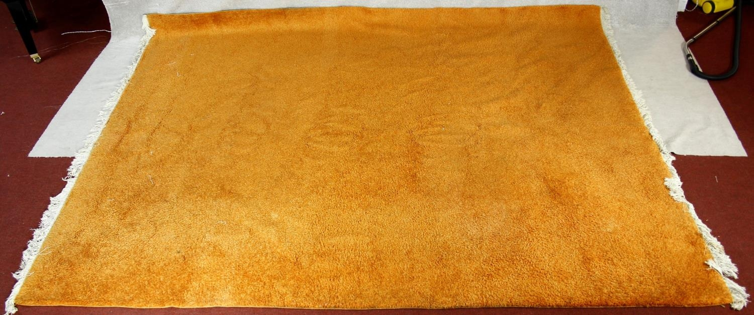 A large 1970's vintage woollen carpet in tangerine retailed by Heal's. L.380 W.280cm