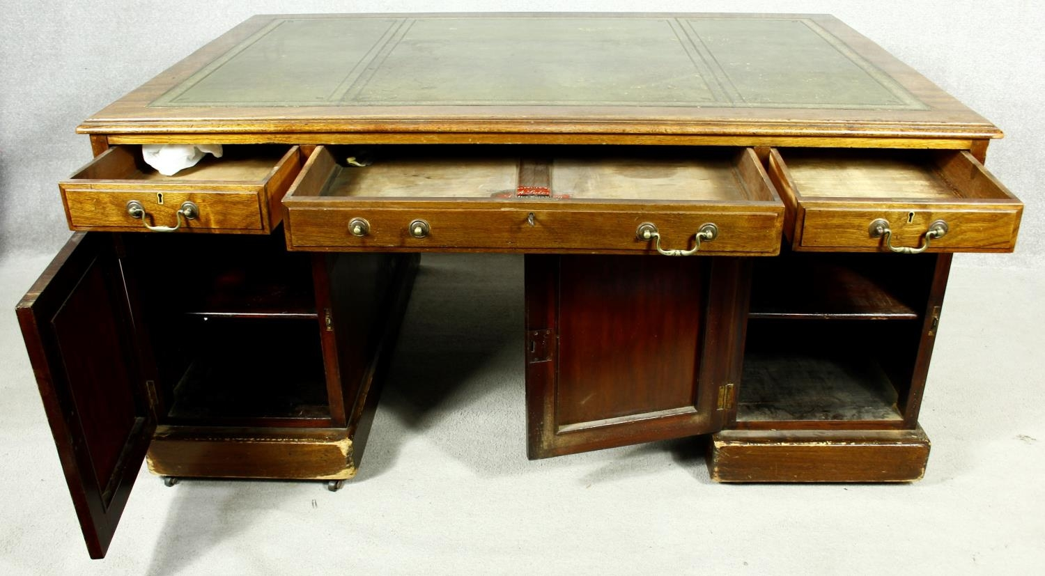 A C.1900 mahogany three section partner's pedestal desk with inset tooled leather top above an - Image 4 of 20