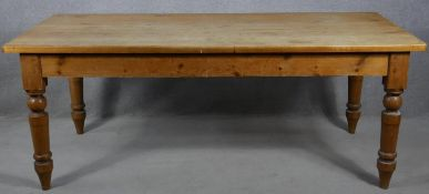 A Victorian style pine refectory farmhouse kitchen table on turned tapering supports. H.76.5 L.199