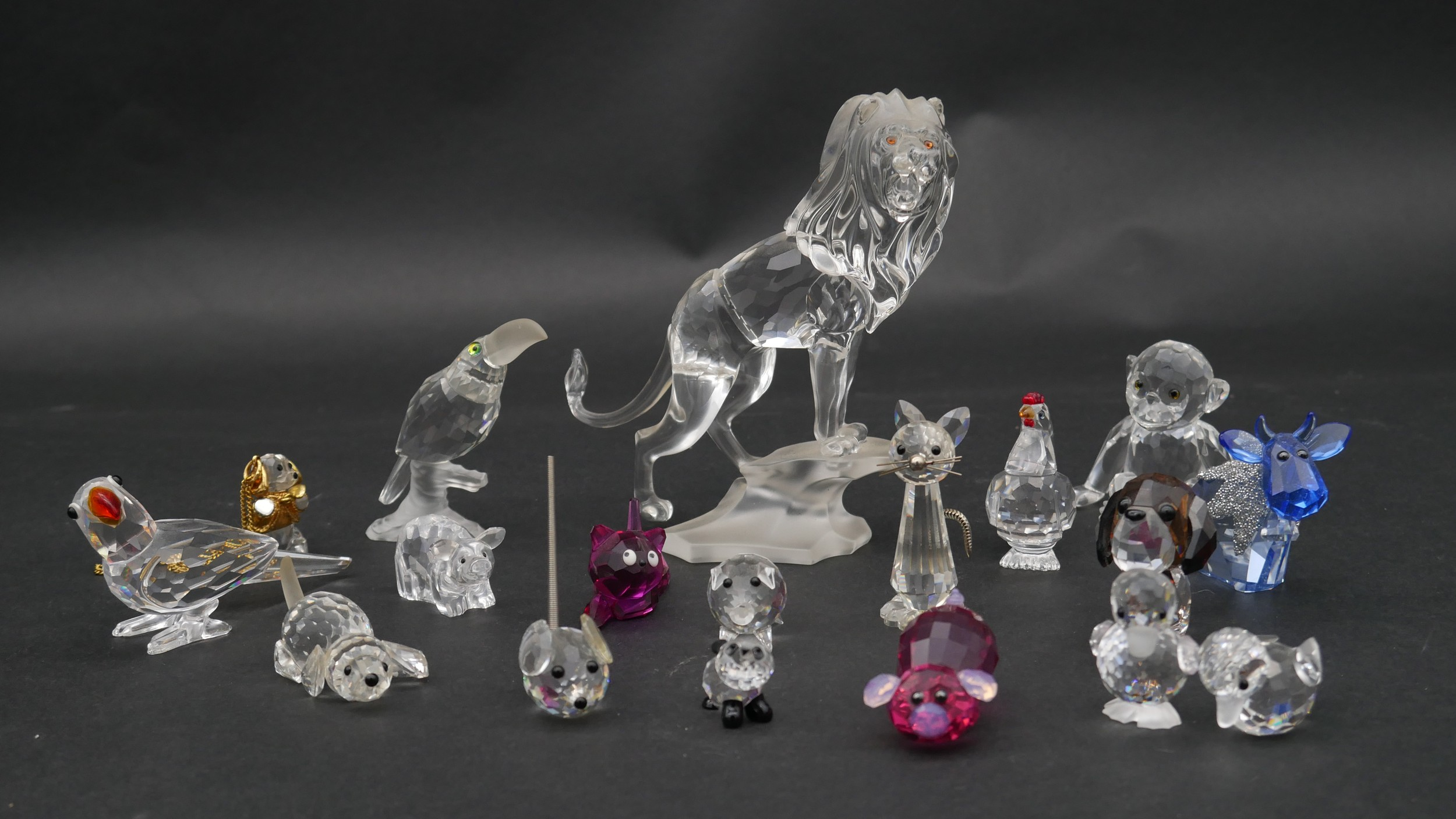 A collection of seventeen Swarovski cut crystal miniature animals to include a roaring lion,
