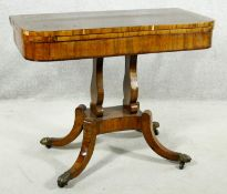 A Regency rosewood card table with foldover baize lined top on twin lyre shaped supports resting
