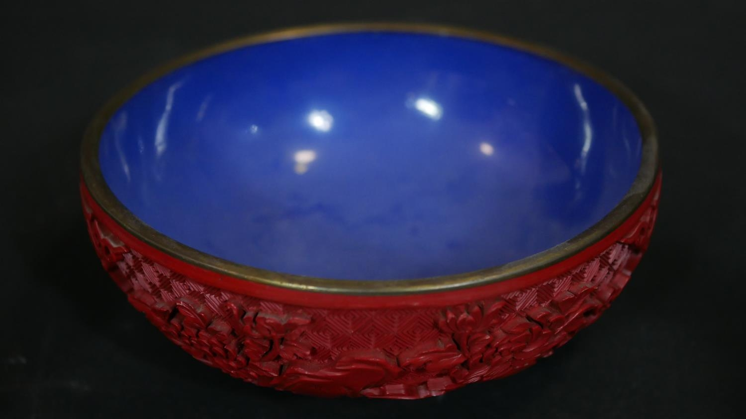 A Chinese carved cinnabar lacquer bowl with blue enamel interior and a pair of similar vases. Dia. - Image 6 of 9