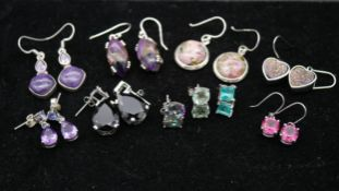 Ten pairs of gemset silver earrings with seven certificates. To include five pairs of drop