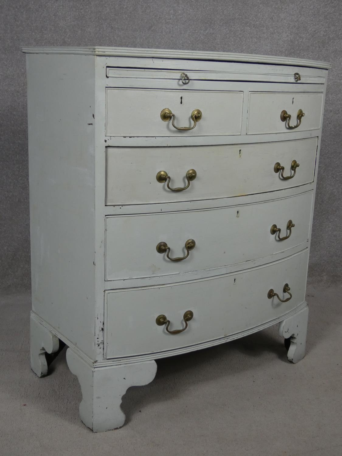 A Georgian style white painted bowfronted chest of drawers with brushing slide and brass swan neck - Image 2 of 10