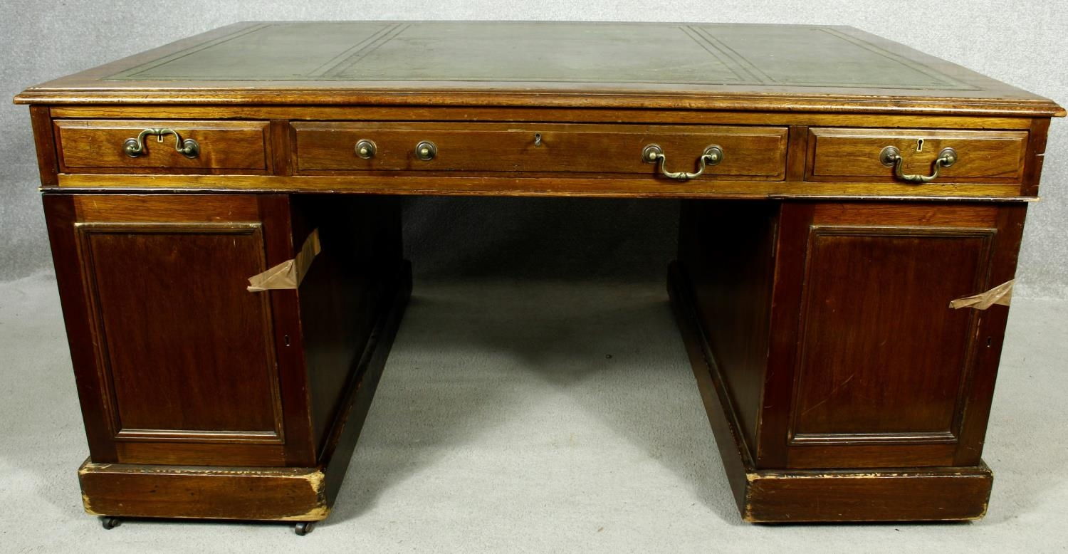 A C.1900 mahogany three section partner's pedestal desk with inset tooled leather top above an - Image 3 of 20