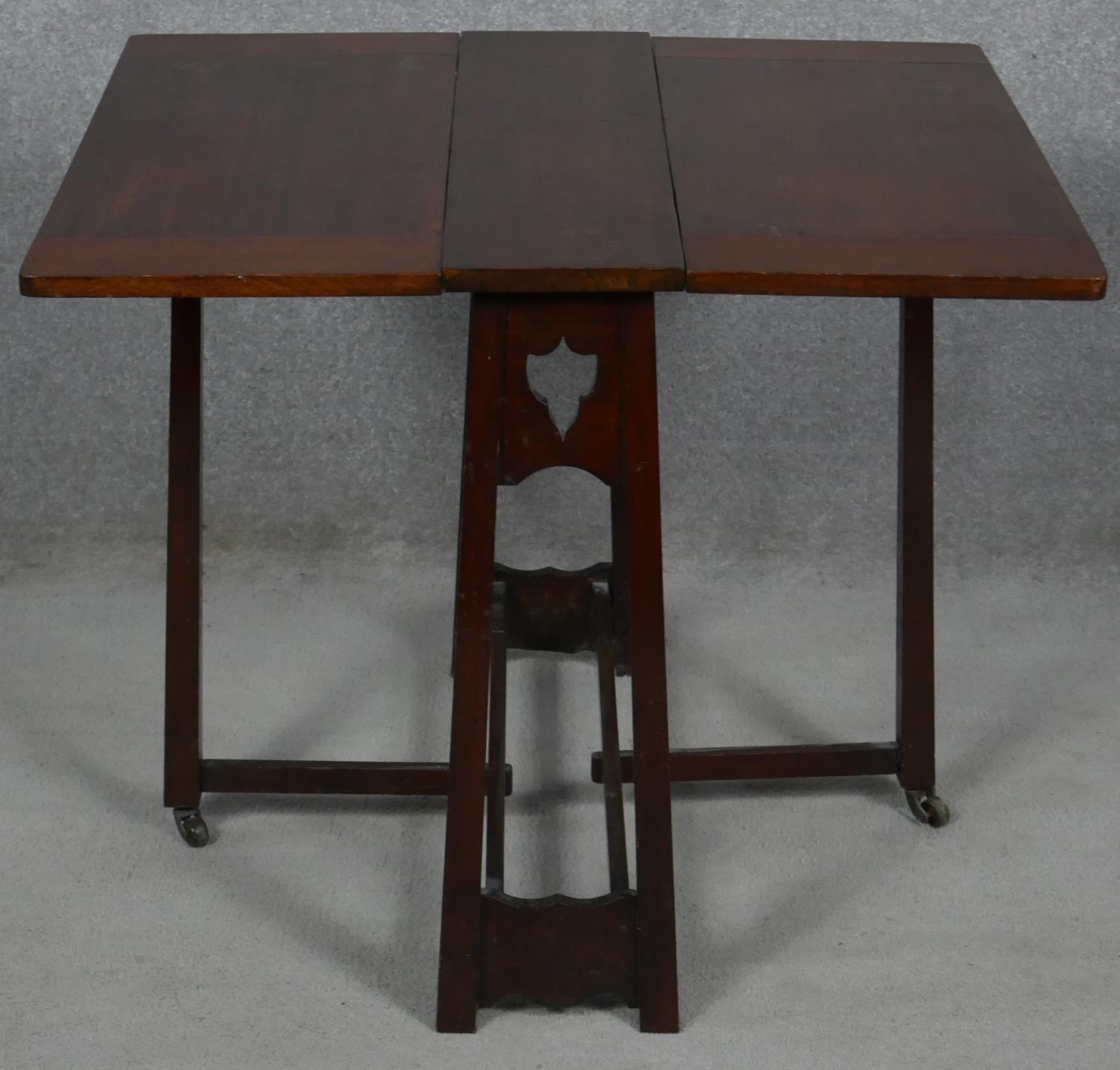 A late 19th century Art and Crafts walnut drop flap Sutherland table. H.57 L.69 W.64cm - Image 2 of 4