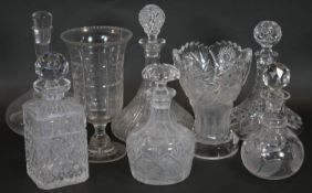 A collection of six glass decanters and stoppers along with two cut crystal vases. H.29cm