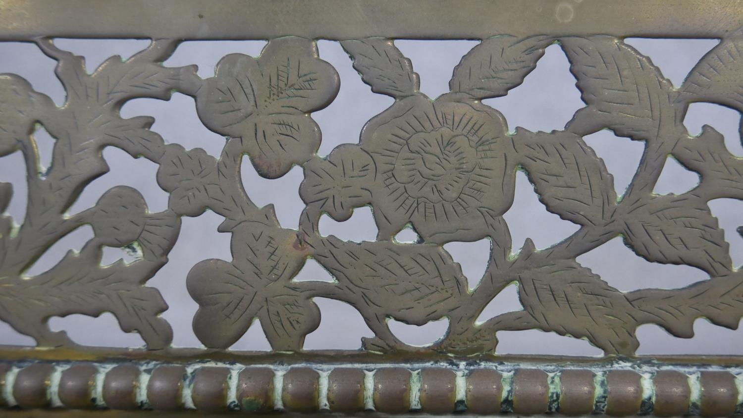 A 19th century pierced floral decorated fire fender. H.18.5 W.125 D.30cm - Image 4 of 4