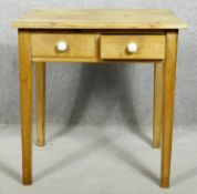 A 19th century pine side table with frieze drawers on square tapering supports. H.63 W.63 D.45cm