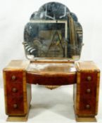 A mid century Art Deco style burr walnut dressing table with cloud shaped bevelled mirror above