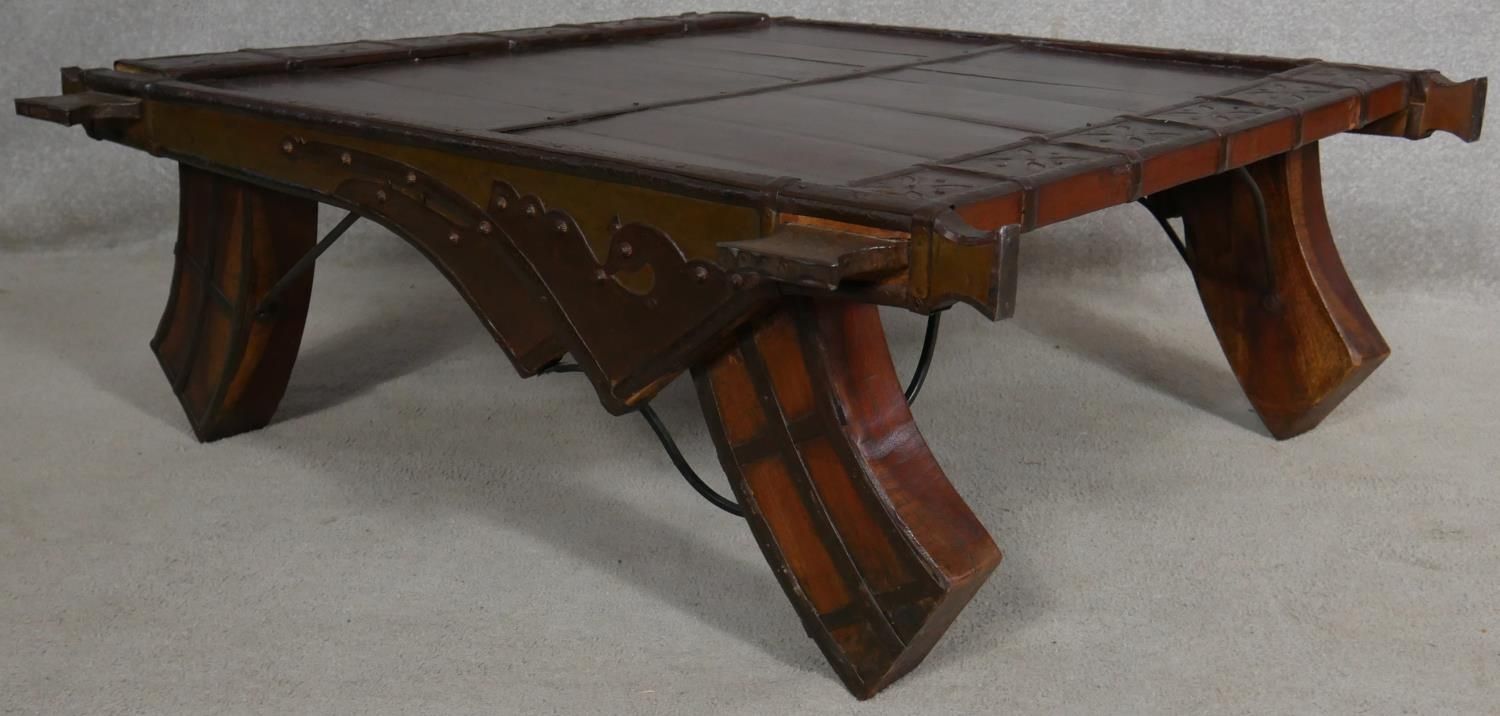 An Eastern hardwood metal bound coffee table on shaped swept supports. H.36 L.103 W.98cm - Image 4 of 5