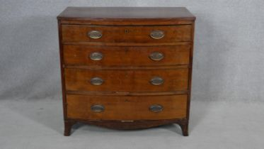 A Regency mahogany bowfronted chest of drawers with crossbanded and ebony strung top on swept