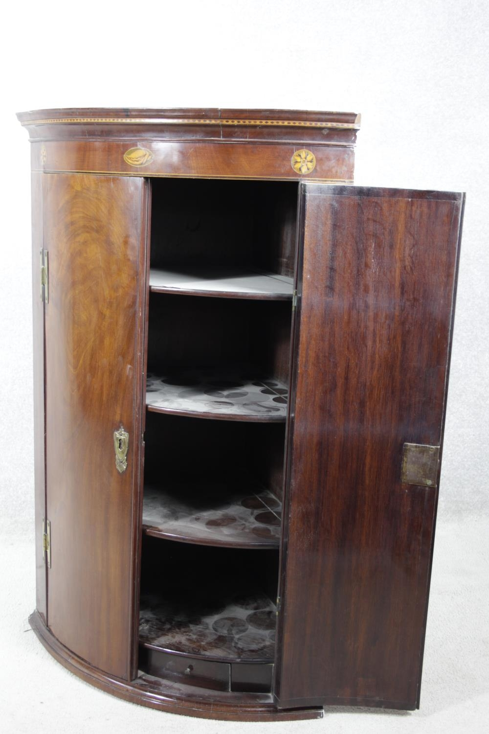 A Georgian figured mahogany bowfronted corner cupboard with satinwood and olivewood conch and floral - Image 3 of 14
