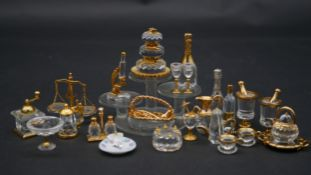 A collection of twenty three Swaovski crystal memories with gilt metal detailing and display
