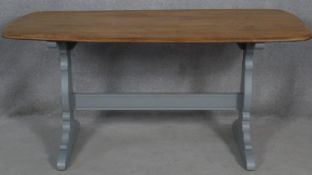 A mid century vintage light elm Ercol refectory style dining table on painted base. H.71.5 L.153 W.