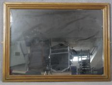 A rectangular wall mirror in painted moulded frame. H.84.5 W.114.5cm