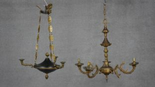 An antique brass and metal three branch ceiling chandelier along with a gilt five branch chandelier.