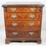 A mid Georgian style burr elm and walnut feather banded bachelors chest with star inlaid foldover